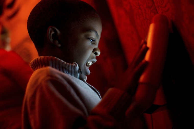 "In this Sunday, Nov. 20, 2016, photo, Jordan Mack, 4, plays on an iPad inside the ""Adventure to Santa,"" a DreamWorks DreamPlace experience at North Point Mall, in Alpharetta, Ga. The Santa experience has gotten a makeover as many malls are installing shows and games they hope will lure shoppers who are buying more online. (AP Photo/Branden Camp)"