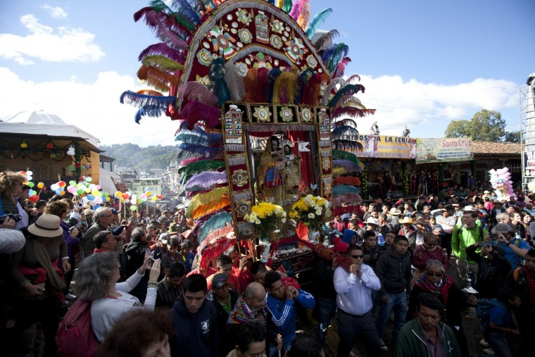 Men carry an elaborate statue of Saint Thomas during a celebration honoring the patron saint of Chichicastenango, Guatemala, Wednesday, Dec. 21, 2016. The Feast of Saint Thomas draws international tourists with its colorful pageantry, but at its heart is a religious celebration melding Catholic and indigenous traditions that culminates on Dec. 21. (AP Photo/Moises Castillo)