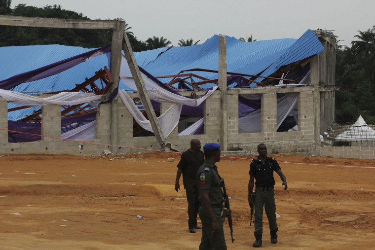 Security men at the site of a collapsed church in Uyo, Nigeria Sunday, Dec. 11, 2016. Metal girders and the roof of a crowded church collapsed onto worshipers, Saturday, killing at least 160 people with the toll likely to rise, a hospital director said Sunday. (AP Photo)