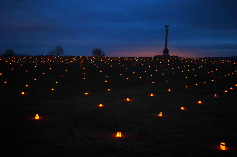 The New York State Monument rises above the luminaries during the 28th Annual Memorial Illumination of over 23,000 luminaries at Antietam National Battlefield. (Karl Merton Ferron/Baltimore Sun)