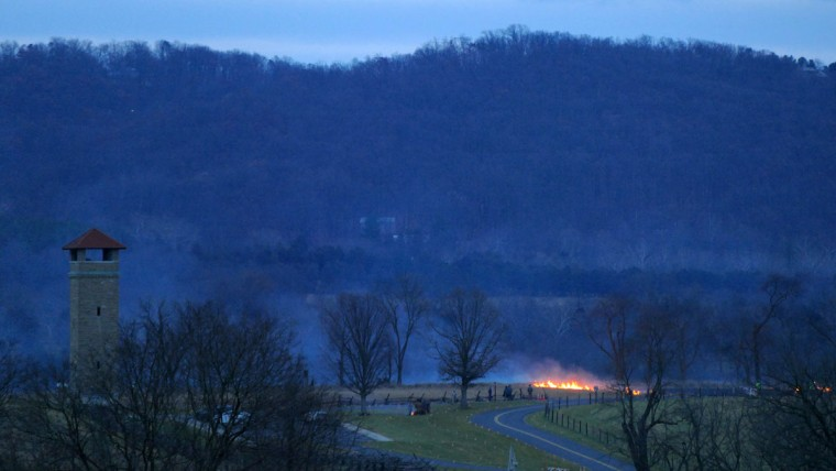 The observation tower rises above the hillside while a fire consumes some dry cornfield and fence timber along Richardson Avenue which caused some concern among the volunteers at dusk during the 28th Annual Memorial Illumination of over 23,000 luminaries at Antietam National Battlefield. (Karl Merton Ferron/Baltimore Sun)