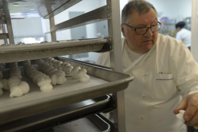 Chef Gerard Billebault of Bonjour prepares Buche de Noel cake the same way his own father did in Paris, decades ago. (Christina Tkacik/Baltimore Sun)