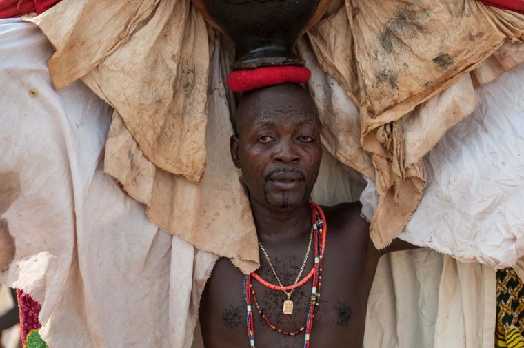 A Voodoo devotee is seen wearing a costume at the annual Voodoo Festival on January 10, 2017 in Ouidah. (STEFAN HEUNIS/AFP/Getty Images)