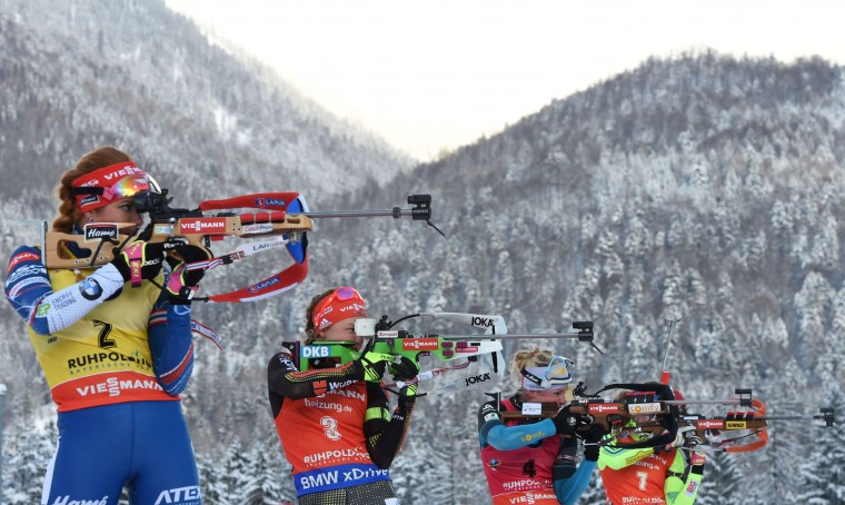 (L-R) Gabriela Koukalova of the Czech Republic, Germany's Laura Dahlmeier, Marie Dorin-Habert of France and Sweden's Hanna Oeberg shoot during the women's 10 km pursuit competition of the Biathlon World Cup on January 15, 2017, in Ruhpolding, southern Germany. (Christof Stache/AFP/Getty Images)