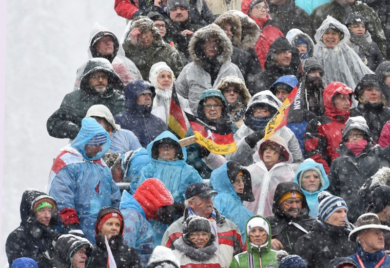 Spectators wait during heavy snow fall prior the women 7,5 km sprint at the Biathlon World Cup on January 14, 2017, in Ruhpolding, southern Germany. (Christof Stache/AFP/Getty Images)