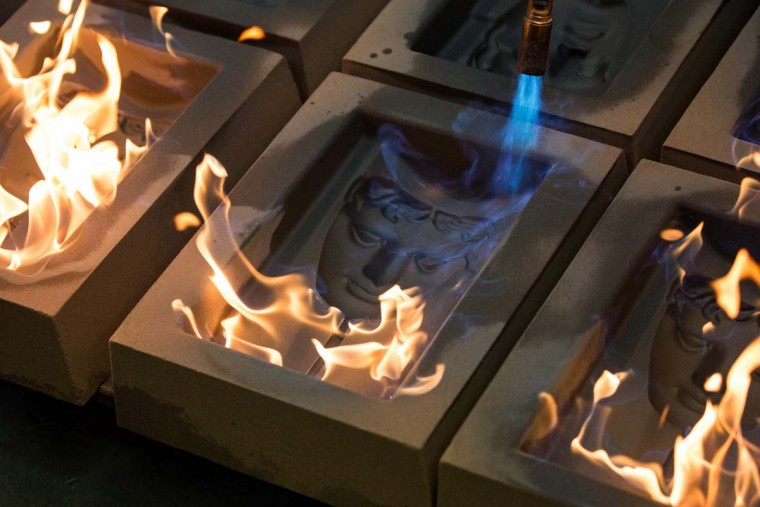 BAFTA (British Academy of Film and Television Arts) mask moulds are set alight to burn off any impurities before casting, during a photocall at the New Pro Foundries, west of London on January 31, 2017. They are set alight to burn off any impurities before casting, (DANIEL LEAL-OLIVAS/AFP/Getty Images)