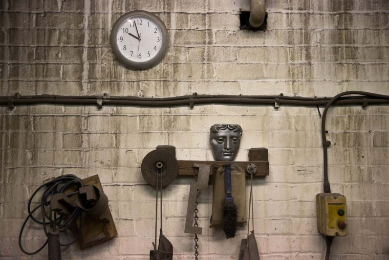 A decorative BAFTA (British Academy of Film and Television Arts) mask is pictured as it hangs on a wall during a photocall at the New Pro Foundries, west of London on January 31, 2017. The masks will be presented to winners at BAFTA's awards ceremony in London on February 12, 2017. (DANIEL LEAL-OLIVAS/AFP/Getty Images)