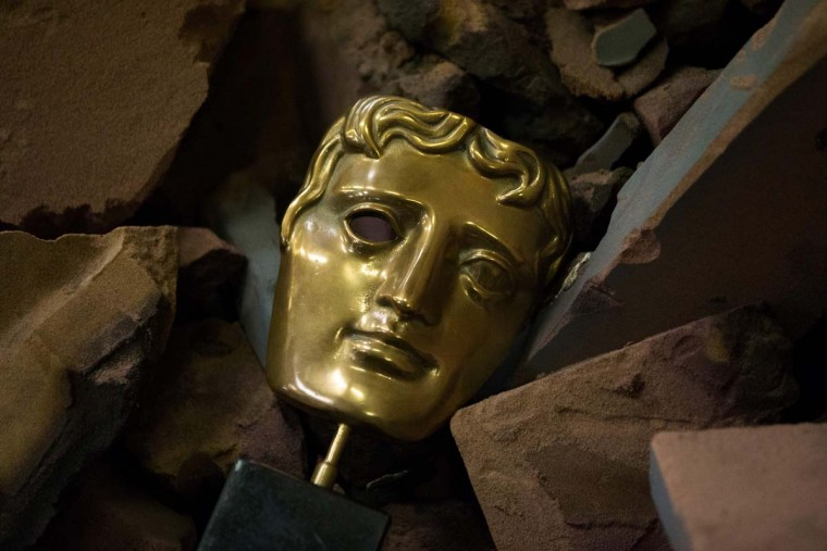 A completed BAFTA (British Academy of Film and Television Arts) masks is pictured among broken moulds during a photocall at the New Pro Foundries, west of London on January 31, 2017. The masks will be presented to winners at BAFTA's awards ceremony in London on February 12, 2017. (DANIEL LEAL-OLIVAS/AFP/Getty Images)