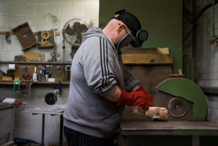 A worker polishes and refines a freshly-cast BAFTA (British Academy of Film and Television Arts) mask during a photocall at the New Pro Foundries, west of London on January 31, 2017. The masks will be presented to winners at BAFTA's awards ceremony in London on February 12, 2017. (DANIEL LEAL-OLIVAS/AFP/Getty Images)