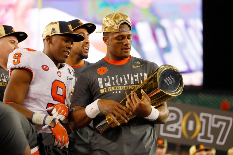 Quarterback Deshaun Watson #4 of the Clemson Tigers celebrates with the College Football Playoff National Championship Trophy after defeating the Alabama Crimson Tide 35-31 to win the 2017 College Football Playoff National Championship Game at Raymond James Stadium on January 9, 2017 in Tampa, Florida. (Photo by Kevin C. Cox/Getty Images)