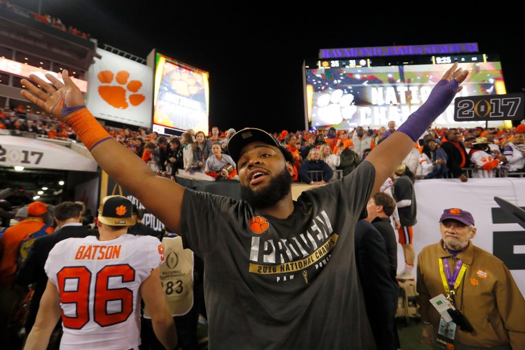 Defensive tackle Carlos Watkins #94 of the Clemson Tigers celebrates after defeating the Alabama Crimson Tide 35-31 to win the 2017 College Football Playoff National Championship Game at Raymond James Stadium on January 9, 2017 in Tampa, Florida. (Photo by Kevin C. Cox/Getty Images)
