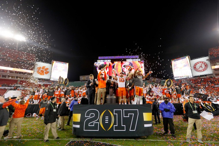 Head coach Dabo Swinney of the Clemson Tigers (L) and linebacker Ben Boulware #10 (C) celebrate after defeating the Alabama Crimson Tide 35-31 to win the 2017 College Football Playoff National Championship Game at Raymond James Stadium on January 9, 2017 in Tampa, Florida. (Photo by Kevin C. Cox/Getty Images)