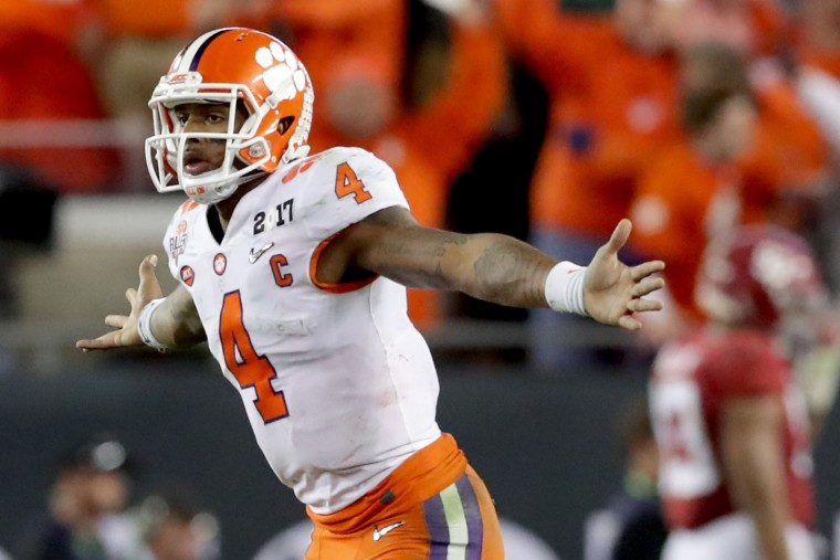 Quarterback Deshaun Watson #4 of the Clemson Tigers celebrates after throwing a 2-yard game-winning touchdown pass during the fourth quarter against the Alabama Crimson Tide to win the 2017 College Football Playoff National Championship Game 35-31 at Raymond James Stadium on January 9, 2017 in Tampa, Florida. (Photo by Streeter Lecka/Getty Images)