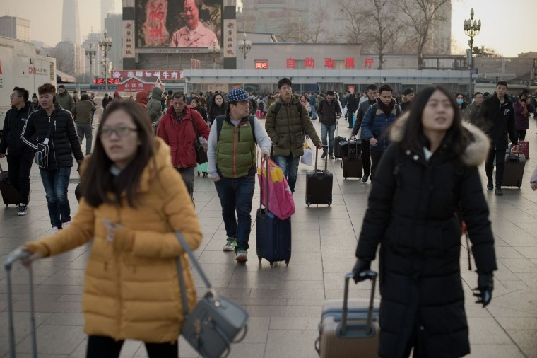 "Passengers arrive at the train station as they prepare to travel to their hometowns for the ""Spring Festival"" or Lunar New Year on January 24, 2017 at Beijing Railway Station. The huge movement of Chinese travelling home to spend the Lunar New Year with their families is often described as the world's largest human migration and overcrowded planes, trains and automobiles are the norm. (Nicolas Asfouri/AFP/Getty Images)"