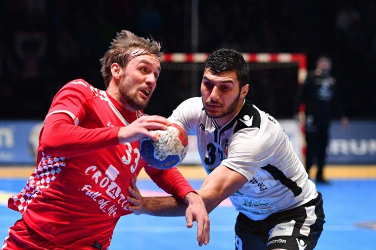 Croatia's center back Luka Cindric (left) holds the ball during the 25th IHF Men's World Championship 2017 eighth final handball match Croatia vs Egypt on January 22, 2017 at the Arena in Montpellier. (PASCAL GUYOT/AFP/Getty Images)