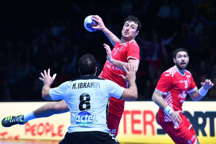 Croatia's center back Domagoj Duvnjak (center) jumps to shoot on goal during the 25th IHF Men's World Championship 2017 eighth final handball match Croatia vs Egypt on January 22, 2017 at the Arena in Montpellier. (PASCAL GUYOT/AFP/Getty Images)