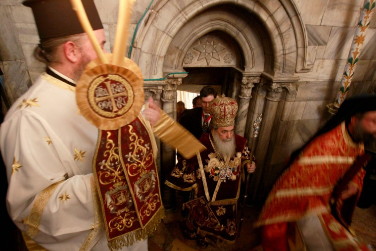 Greek Orthodox Patriarch of Jerusalem Theophilos III (C) leads the midnight mass at the Church of the Nativity in the biblical West Bank town of Bethlehem as Orthodox Christmas celebrations kicked off on January 7, 2017, in the traditional birthplace of Jesus Christ. (AFP PHOTO / MUSA AL SHAER)