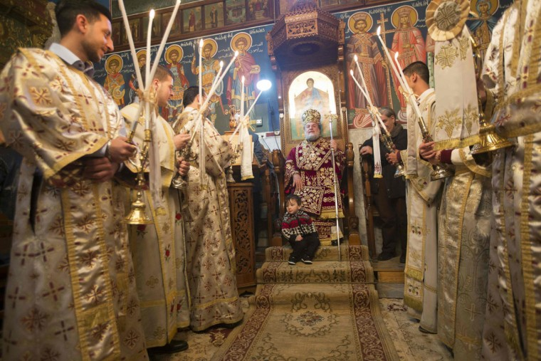 Archbishop Alexios leads a Christmas mass at the Saint Porphyrios Greek Orthodox church in Gaza City on January 7, 2017. According to the Gregorian calendar, Orthodox Christmas falls 13 days after the December 25 Western feast celebrated in line with the Julian calendar. (AFP PHOTO / MAHMUD HAMS)