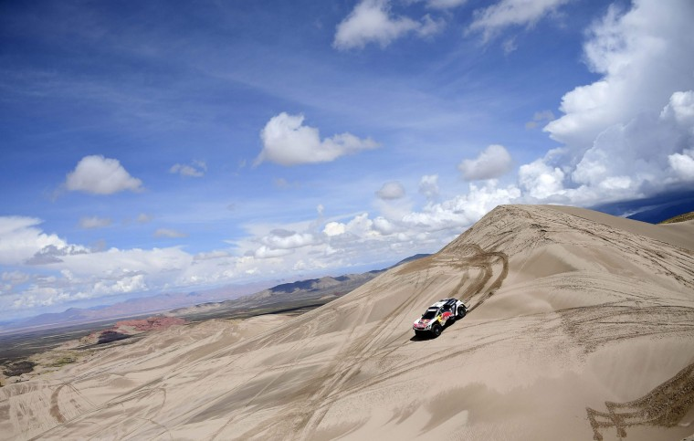 Peugeot's Spanish drivers Carlos Sainz and Lucas Cruz compete during Stage 4 of the 2017 Dakar Rally between San Salvador de Jujuy in Argentina and Tupiza in Bolivia, on January 5, 2017. (Franck Fife/AFP/Getty Images)