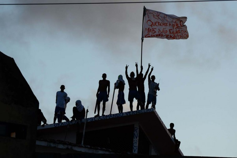 Prisoners atop the roof of the compound celebrate the transfer of their leaders after a negotiation with the police at the Alcacuz Penitentiary, near Natal, Rio Grande do Norte, on January 16, 2017. Authorities thought inmates at the Alcacuz jail near the northeastern city of Natal were under control following the quelling of a deadly riot that broke out Saturday, until some climbed to the roof on Monday. On Sunday, police had stormed the prison and ended a night-long riot. They found 26 prisoners dead, most of them beheaded, officials said. (ANDRESSA ANHOLETE/AFP/Getty Images)