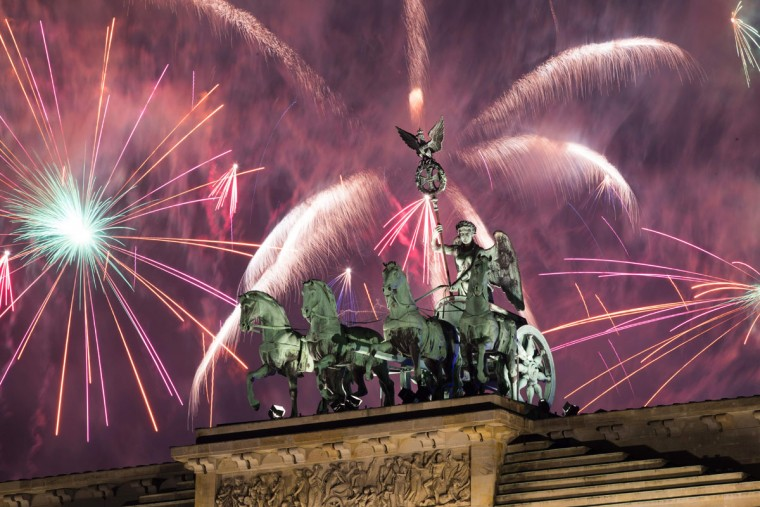 Fireworks explode behind the quadriga of Berlin's landmark Brandenburg Gate to usher in the New Year on January 1, 2017. (AFP PHOTO / Odd Andersen)