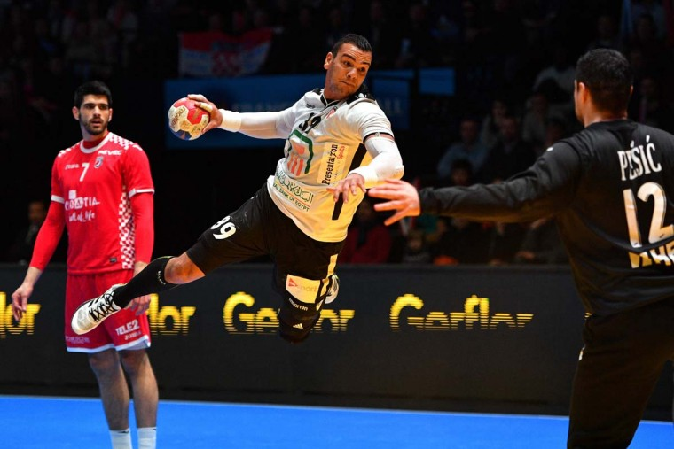 Egypt's pivot Mohamed Mamdouh Shebib (center) jumps to shoot on goal and scores during the 25th IHF Men's World Championship 2017 eighth final handball match Croatia vs Egypt on January 22, 2017 at the Arena in Montpellier. (PASCAL GUYOT/AFP/Getty Images)
