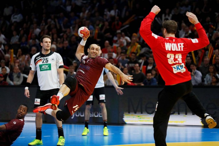 Qatar's pivot Bassel Alrayes (left) jumps to shoot on goal against Germany's goalkeeper Andreas Wolff during the 25th IHF Men's World Championship 2017 eighth final handball match Germany vs Qatar on January 22, 2017 at the AccorHotels Arena in Paris. (THOMAS SAMSON/AFP/Getty Images)