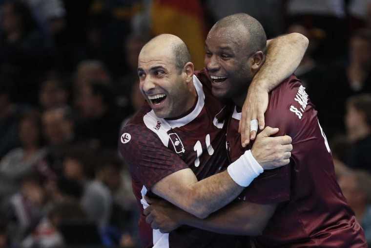 Qatar's pivot Bassel Alrayes (left) and left wing Hassan Mabrouk celebrate after Qatar defeated Germany in the 25th IHF Men's World Championship 2017 eighth final handball match Germany vs Qatar on January 22, 2017 at the AccorHotels Arena in Paris. (THOMAS SAMSON/AFP/Getty Images)