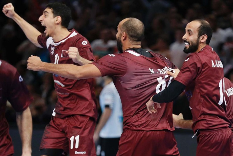 From left, Qatar's left wing Murad Abdulrazzaq, center back Mahmoud Hassaballa and right wing Abdullah Al Karbi celebrate after Qatar defeated Germany in the 25th IHF Men's World Championship 2017 eighth final handball match Germany vs Qatar on January 22, 2017 at the AccorHotels Arena in Paris. (THOMAS SAMSON/AFP/Getty Images)