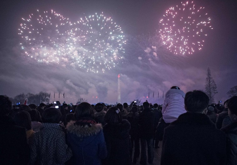 Fireworks light up the sky over Kim Il Sung Square at midnight in Pyongyang to bring in New Year's Day on January 1, 2017. (AFP PHOTO / Kim Won-Jin)