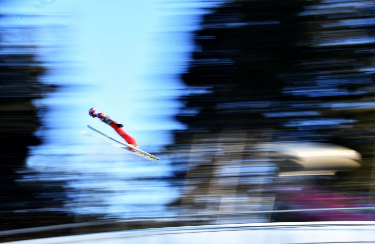 Taku Takeuchi of Japan soars through the air during his trial jump of the ski jumping event in Innsbruck, which is the third station of the Four-Hills Ski Jumping tournament (Vierschanzentournee) on January 3, 2017. (Barbara Gindl/AFP/Getty Images)
