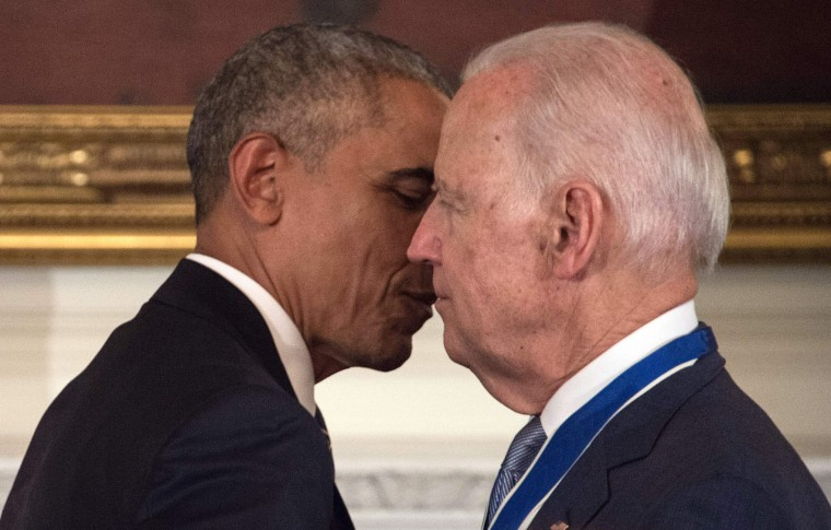 U.S. Vice President Joe Biden and President Barack Obama embrace after Obama awarded him the Presidential Medal of Freedom during a tribute to Biden at the White House in Washington, DC, on January 12, 2017. (Nicholas Kamm/AFP/Getty Images)
