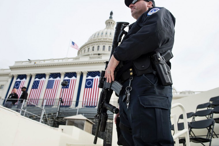 A Capitol Police Officer stands guard before tomorrow's Inauguration on Capitol Hill January 19, 2017 in Washington, DC. With one day to go before he takes the oath of office as the 45th US president, Donald Trump arrives in Washington Thursday determined to transform US politics over the next four years. (AFP PHOTO / Brendan Smialowski)