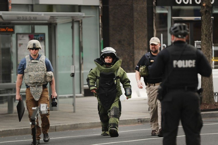 WASHINGTON, DC - JANUARY 19: Members of a bomb disposal team investigate a package downtown on January 19, 2017 in Washington, DC. Security is tight in the nation's capital on the eve of the presidential inauguration. Washington and the entire nation are preparing for the transfer of the United States presidency as Donald Trump is sworn in as the 45th president January 20. (Photo by Spencer Platt/Getty Images)