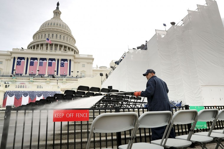 WASHINGTON, DC - JANUARY 19: Architect of the Capitol Stone Mason Division employee Romel Lazo uses a power washer to clean the West Front of the U.S. Capitol one day before the inaguration of Donald Trump January 19, 2017 in Washington, DC. Hundreds of thousands of people are expected to come to the National Mall to witness Trump being sworn in as the 45th president of the United States. (Photo by Chip Somodevilla/Getty Images)