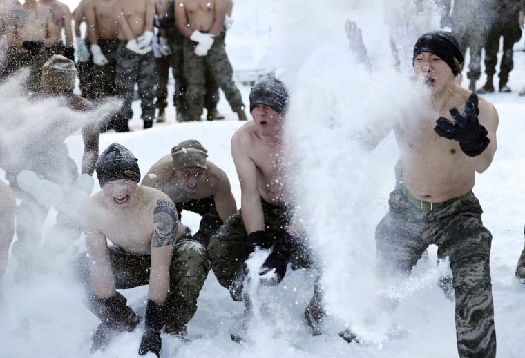 South Korean Marines and U.S. Marines from the 3rd Division Expeditionary Forces throw snow during a combined military winter exercise in Pyeongchang, South Korea, Tuesday, Jan. 24, 2017. Marines from South Korea and U.S. are participating in the four-week winter combined exercise in South Korea. (AP Photo/Lee Jin-man)