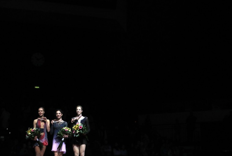 First placed Russia's Evgenia Medvedeva, center, second placed Russia's Anna Pogorilaya, left, and third placed Italy's Carolina Kostner, right, display their medals after the free program at the European Figure Skating Championships in Ostrava, Czech Republic, Friday, Jan. 27, 2017. (AP Photo/Petr David Josek)