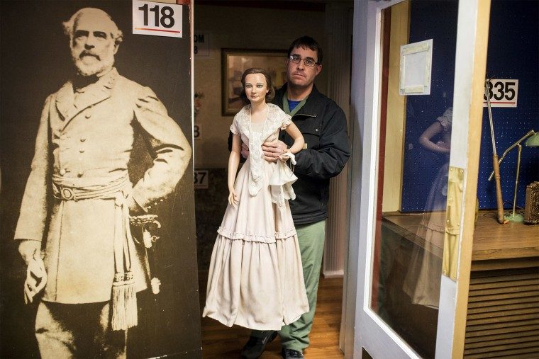 John Buchheister of Gettysburg carries First Lady Abigail Powers Fillmore during the Hall of Presidents and First Ladies Museum wax figures auction in Gettysburg, Pa., Saturday, Jan. 14, 2017. The museum, which displayed the figures of 44 presidents and their first ladies, operated on Baltimore Street for 60 years, the company said in a news release. (Sean Simmers/PennLive.com via AP)
