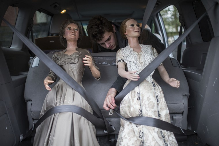 Nick Schaefer of Virginia straps First Ladies Bess Truman and Mary McElroy into the back of his mother's van during the Hall of Presidents and First Ladies Museum wax figures auction in Gettysburg, Pa., Saturday, Jan. 14, 2017. The museum, which displayed the figures of 44 presidents and their first ladies, operated on Baltimore Street for 60 years, the company said in a news release. (Sean Simmers/PennLive.com via AP)