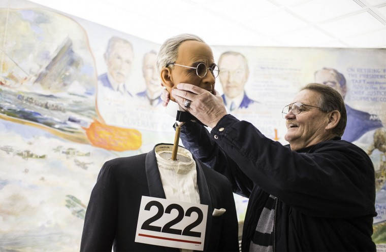 Mike McGough of Adamstown, Pa., lifts the head off of the wax figure of Harry Truman after purchasing him during the Hall of Presidents and First Ladies Museum public auction in Gettysburg, Pa., Jan. 14, 2017. The museum, which displayed the figures of 44 presidents and their first ladies, operated on Baltimore Street for 60 years, the company said in a news release. (Sean Simmers/PennLive.com via AP)