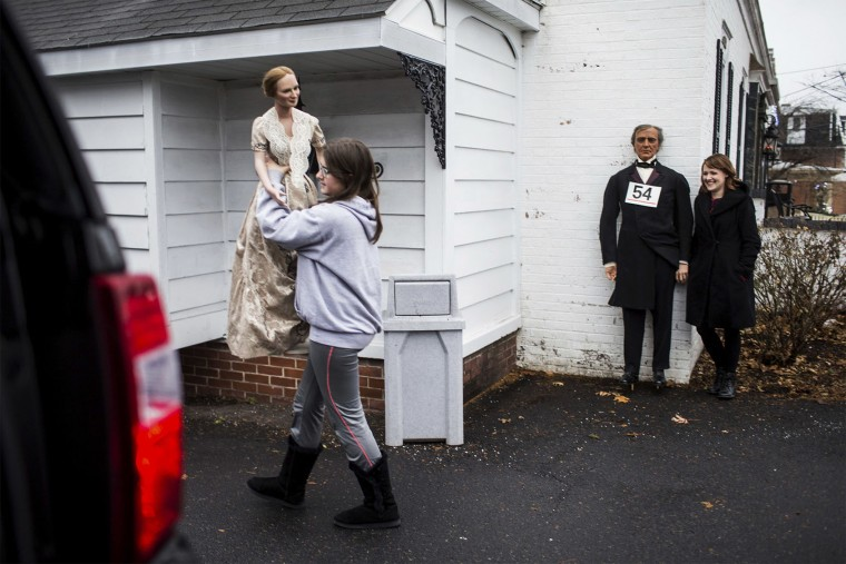 Bidders remove Presidents and First Ladies wax figures during the Hall of Presidents and First Ladies Museum auction in Gettysburg, Pa., Saturday, Jan. 14, 2017. The museum, which displayed the figures of 44 presidents and their first ladies, operated on Baltimore Street for 60 years, the company said in a news release. (Sean Simmers/PennLive.com via AP)