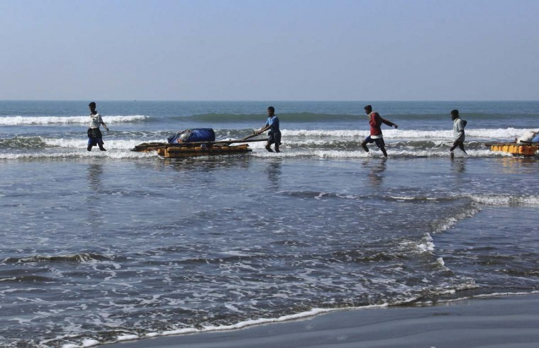 In this Jan. 16, 2017, photo, Rohingya fishermen pull their rafts made of empty plastic containers along the shallow coastline of the Bay of Bengal in Tha Pyay Taw village, Maungdaw, western Rakhine state, Myanmar. Their usual, sturdy fishing boats were outlawed three months ago when Myanmar authorities launched a sweeping and violent counter-insurgency campaign in Rakhine state, home to the long-persecuted Rohingya Muslim minority. The ban on fishing boats --meant to prevent insurgents from entering or leaving the country by sea -- is just one small provision in the wider crackdown, in which authorities have been accused of widespread abuses. (AP Photo/Esther Htusan)
