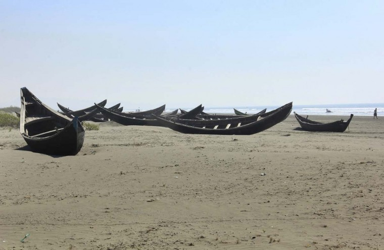 In this Jan. 16, 2017, photo, traditional wooden boats of the Rohingya fishermen sit along the beach abandoned in Maungdaw, western Rakhine state, Myanmar. Their usual, sturdy fishing boats were outlawed three months ago when Myanmar authorities launched a sweeping and violent counter-insurgency campaign in Rakhine state, home to the long-persecuted Rohingya Muslim minority. The ban on fishing boats -- meant to prevent insurgents from entering or leaving the country by sea -- is just one small provision in the wider crackdown, in which authorities have been accused of widespread abuses. (AP Photo/Esther Htusan)