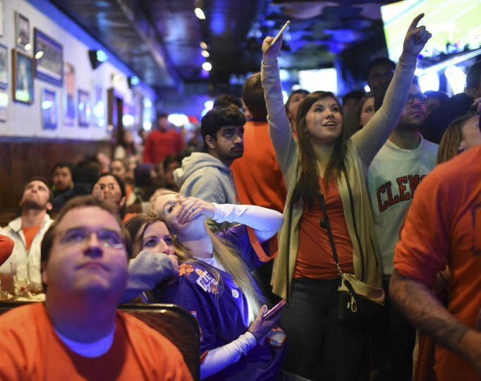 Clemson fans react to an Alabama touchdown during the NCAA college football playoff championship game at Tiger Town Tavern, Monday, Jan. 9, 2017, in Clemson, S.C. (AP Photo/Rainier Ehrhardt)