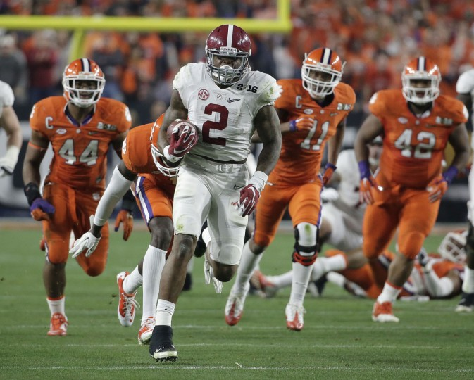 In this Jan. 11, 2016, file photo, Alabama's Derrick Henry runs for a touchdown during the first half of the NCAA college football playoff championship game against Clemson in Glendale, Ariz. Alabama beat Clemson in a thrill-a-minute game in the 2016 college football playoff championship. Heisman Trophy winner Henry ran for three touchdowns, including a 50-yarder to open the scoring. (AP Photo/Chris Carlson, File)