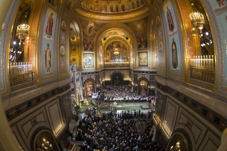 Believers listen as Russian Orthodox Patriarch Kirill serves the Christmas Mass in the Christ the Savior Cathedral in in Moscow, Russia, Friday, Jan. 6, 2017. Orthodox Christians celebrate Christmas on Jan. 7, in accordance with the Julian calendar. (AP Photo/Alexander Zemlianichenko)