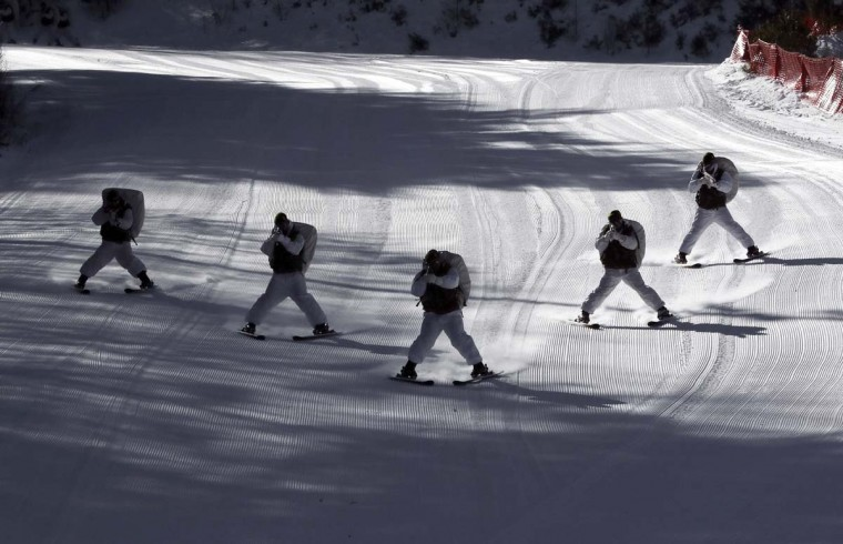 South Korean Marines ski during a combined military winter exercise with the U.S. Marines in Pyeongchang, South Korea, Tuesday, Jan. 24, 2017. Marines from South Korea and the U.S. are participating in the four-week winter combined exercise in South Korea. (AP Photo/Lee Jin-man)