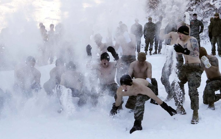 South Korean Marines and U.S. Marines from the 3rd Division Expeditionary Forces throw snow during a combined military winter exercise in Pyeongchang, South Korea, Tuesday, Jan. 24, 2017. Marines from South Korea and U.S. are participating in a four-week winter combined exercise in South Korea. (AP Photo/Lee Jin-man)