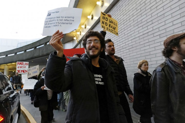 Dozens of demonstrators marched in and around the main terminal at Portland International Airport, to protest President Donald Trump's order restricting immigration into the U.S., Saturday, Jan. 28, 2017, in Portland, Ore. (Mike Zacchino/The Oregonian via AP)