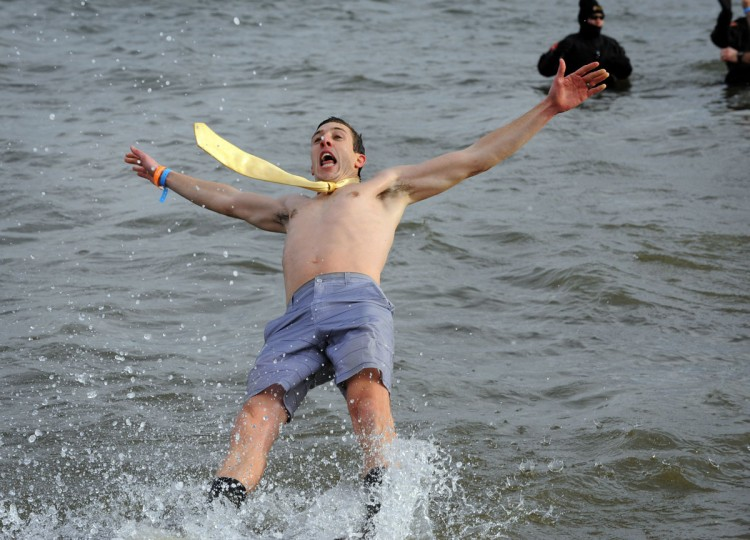 John Paul Devereaux of Baltimore heads into the water during the Corporate Plunge. (Lloyd Fox/Baltimore Sun)